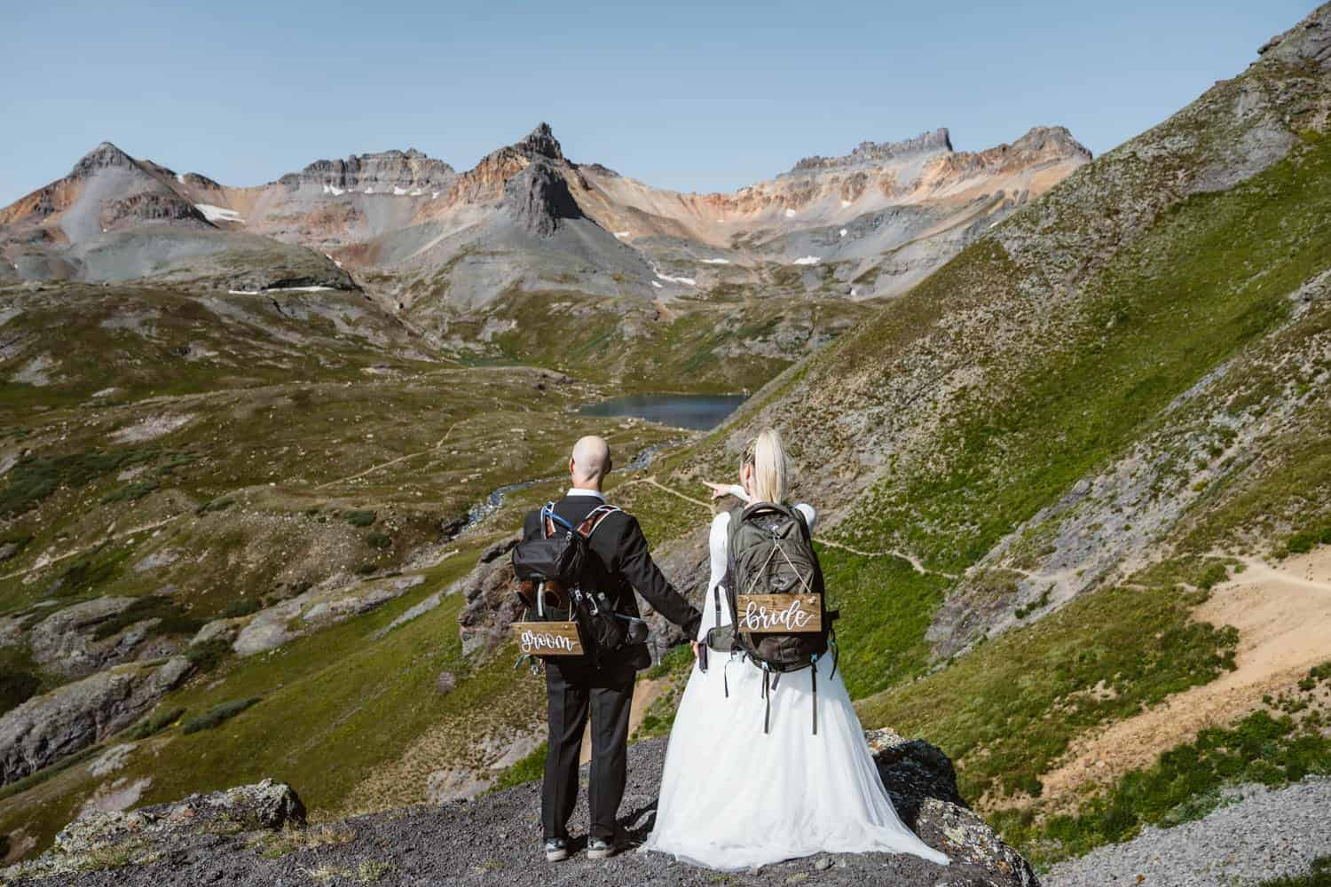 Bride Getting on Cliff Hiking Adventure Elopement