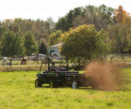 ATV/UTV Small Manure Spreader In A Pasture
