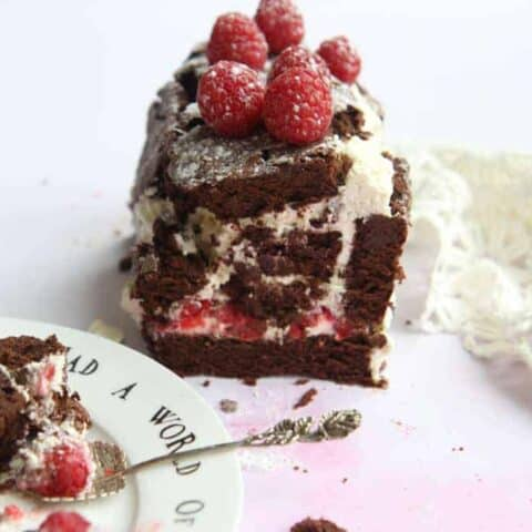 A chocolate roulade, decorated with raspberries
