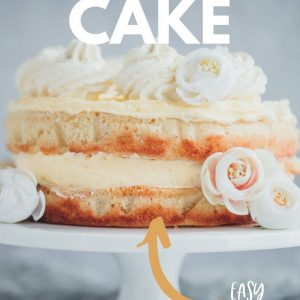 A lemon cake on a white cake stand Pinterest image with text overlay.