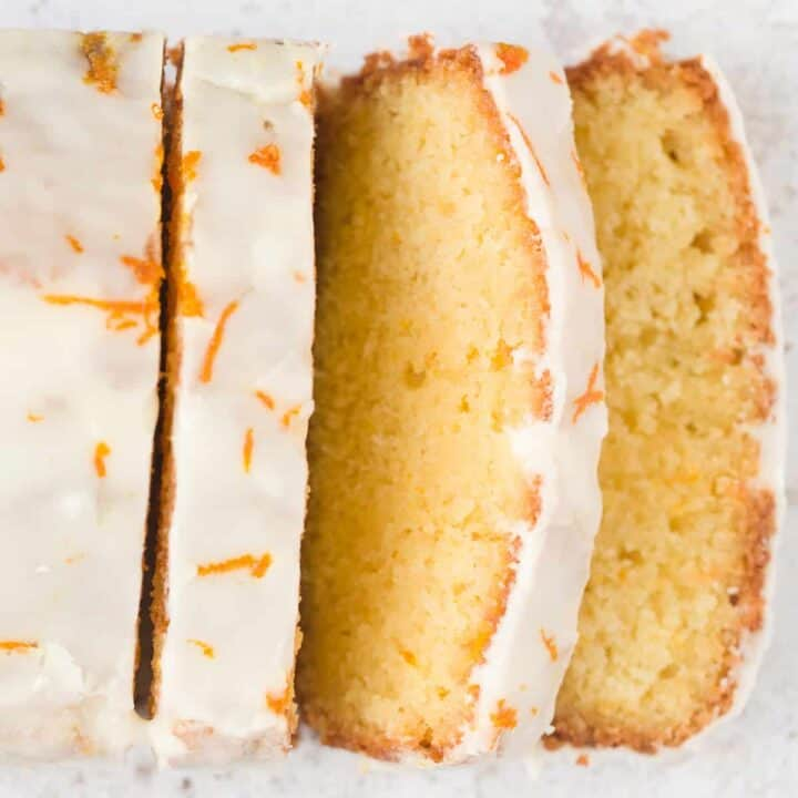 An orange drizzle cake covered in icing.