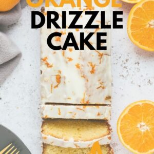 An orange drizzle loaf cake with two slices cut away. Pinterest image with text overlay.