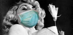 BHoF founder Jennie Lee spins tassels while wearing a medical face mask