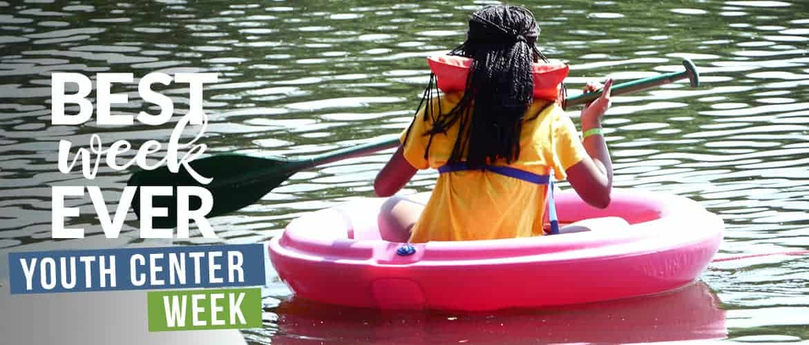 Girl in an inflatable raft on lake