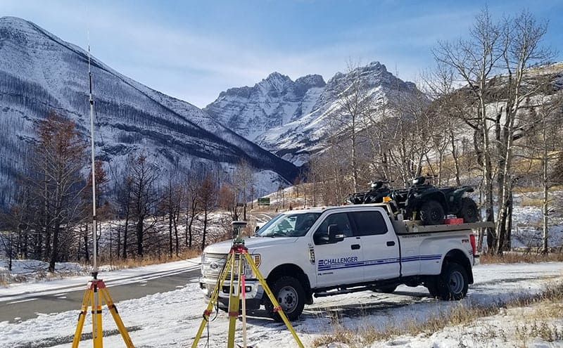 Challenger truck and survey gear in the mountains