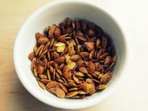 curry pumpkin seeds in a bowl