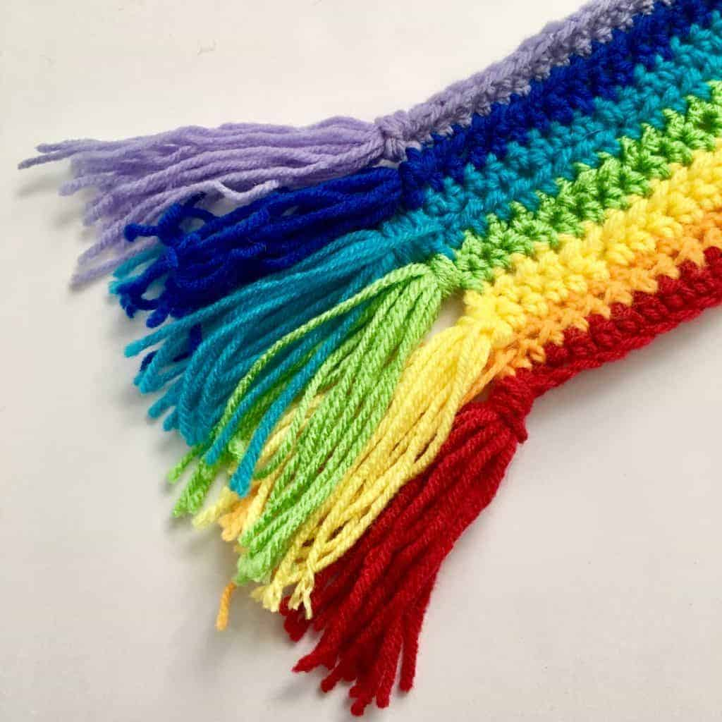 rainbow crochet scarf with frayed ends