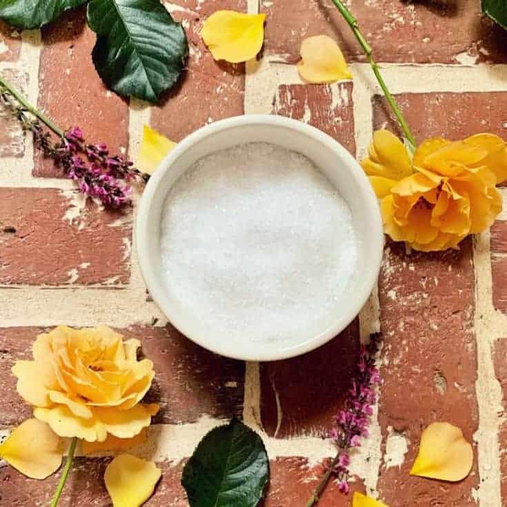 epsom salts in bowl on brick floor