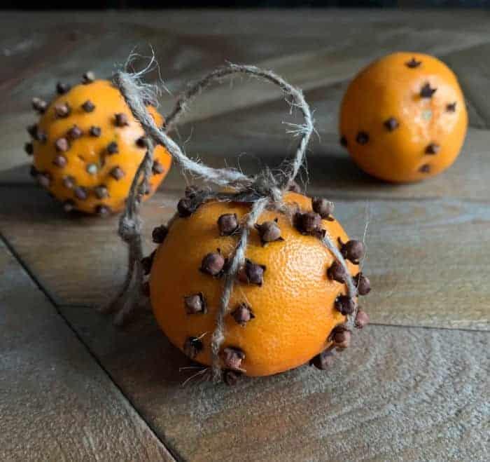 orange pomanders on a wood table