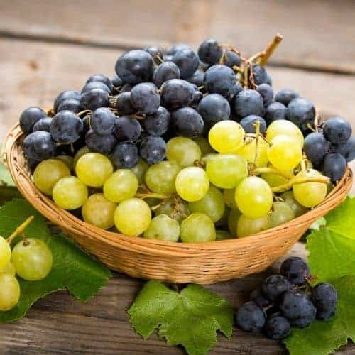 red and green grapes in a bowl
