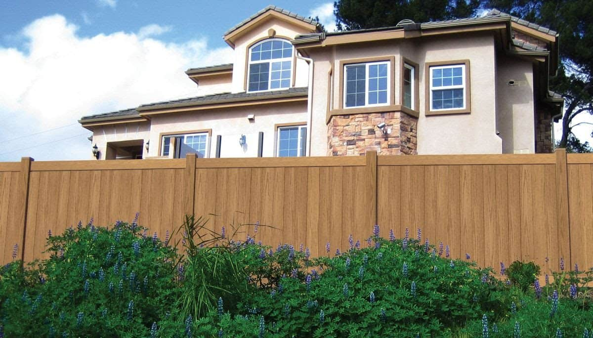 Kevin has installed an elegant Duramax white vinyl fence that would never turn yellow