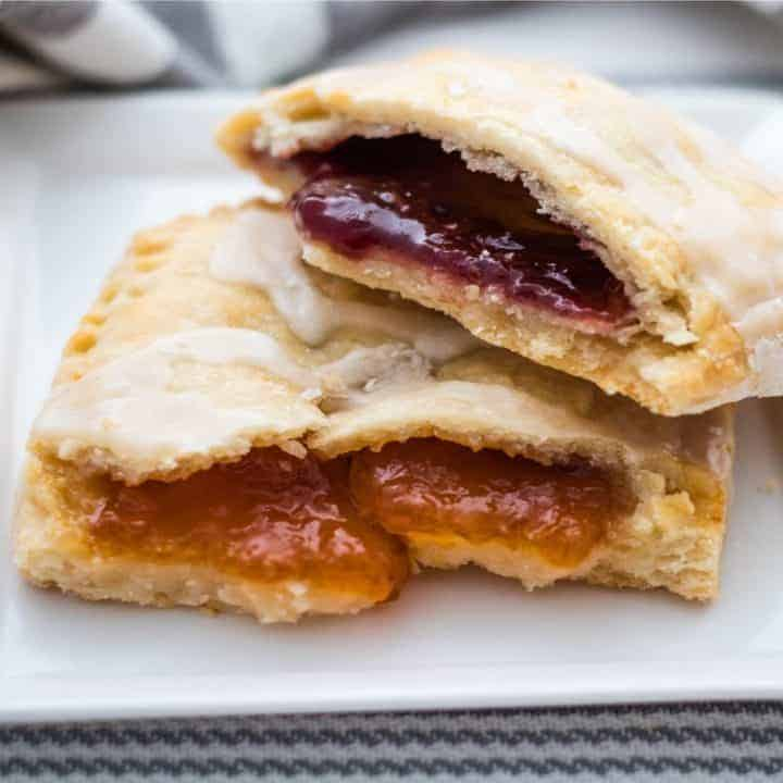 toaster pastries filled with apricot and raspberry jam on white plate