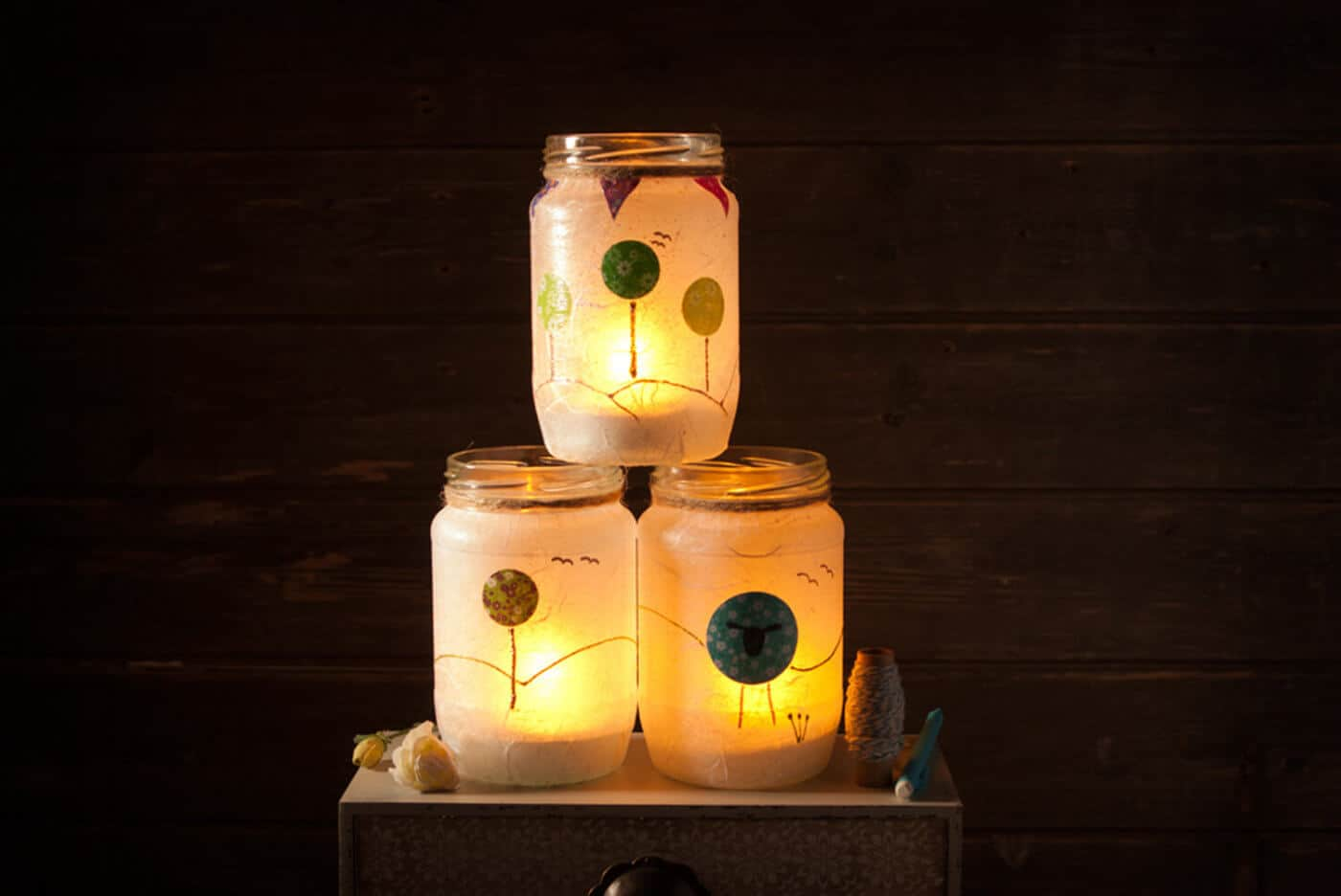 Glass jars photographed in the studio with ambient candle light