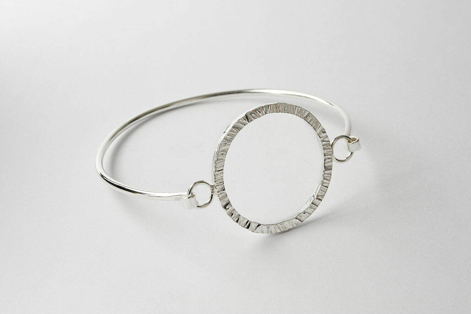 Silver bangle jewellery product photograph for Janet Leitch jewellery designer