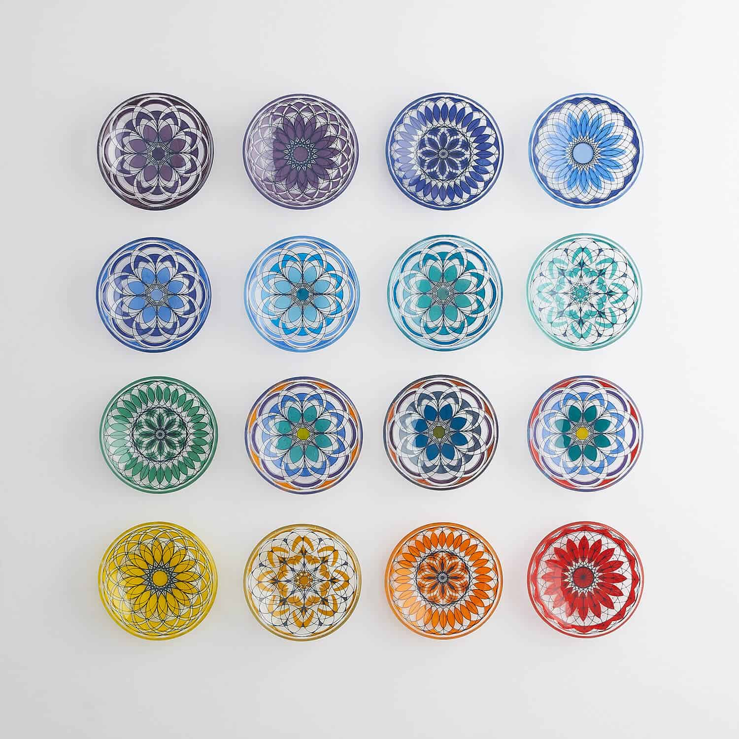 Geometric patterned glassware bowls by glass artist Helen Tiffany photographed from above with soft diffused light