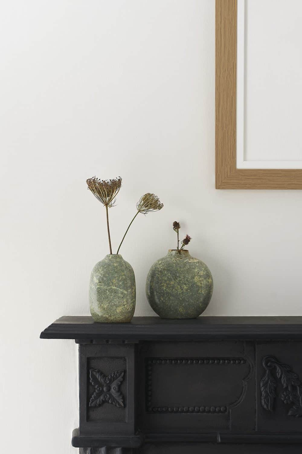Hand sculpted vases created by Jennifer Tetlow photographed in lifestyle setting upon the studio fireplace