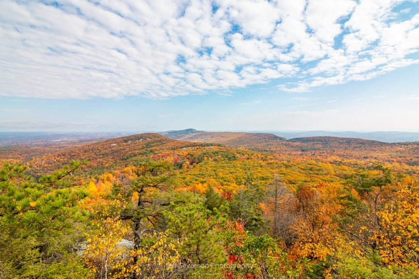 A photo of the autumn landscape in the New Paltz region and surrounding Hudson Valley from one of the lookouts on the Beacon Hill Trail at Minnewaska State Park.