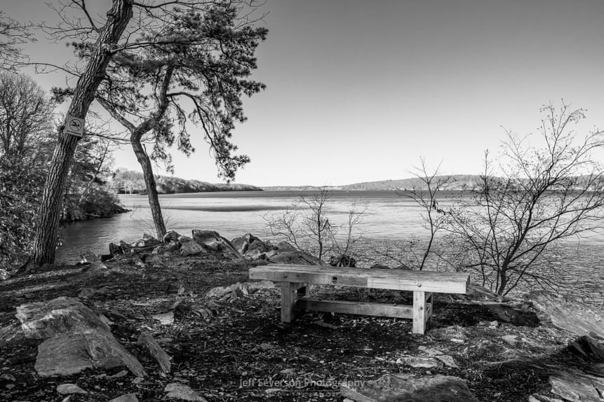 A black and white photo of the Hudson River from the Pitch Pine Overlook at Black Creek Preserve in Esopus, NY.