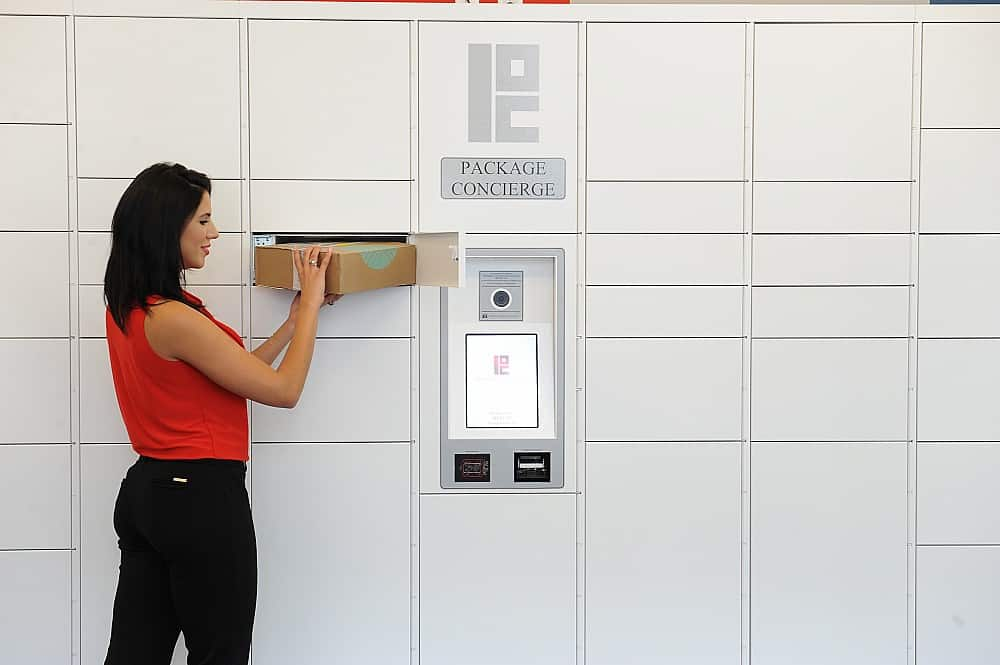 woman retrieving order from digital retail lockers