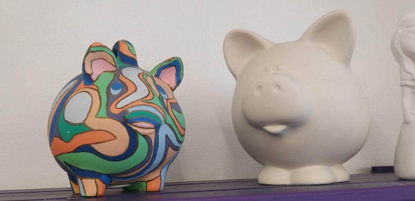 painted and unpainted pottery pigs