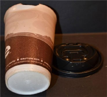 damaged plastic coffee cup