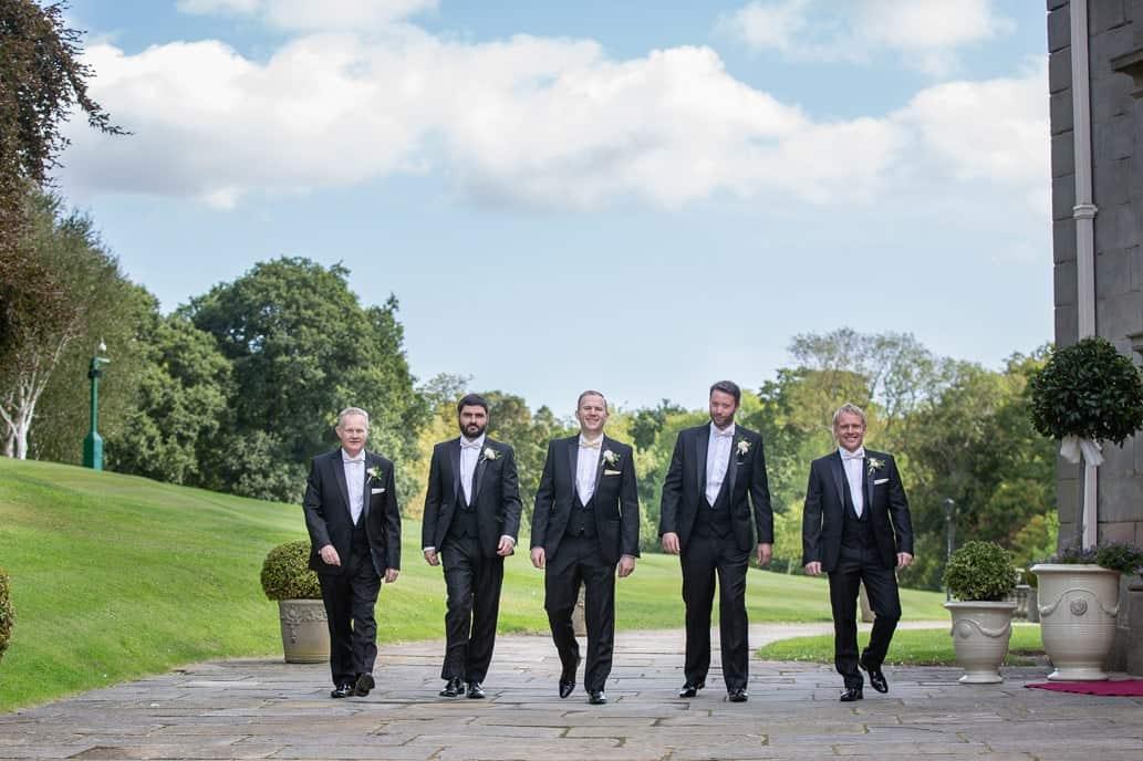 The groom walking to Wynyard Hall wedding