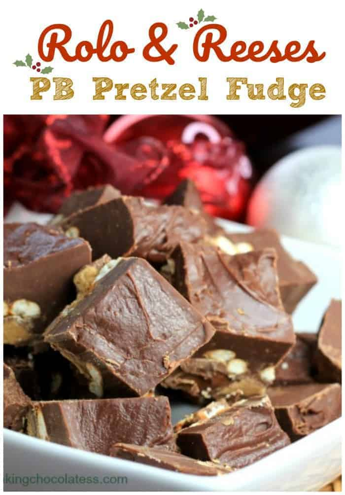 Rolo Reeses PB Pretzel Fudge - An outrageous outburst of Reeses\' peanut butter cups, crunchy salted pretzels and caramel Rolos\' surrounded in a smooth chocolate fudge on top. #chocolate #fudge #peanut butter #pretzel #reeses #rolo #holiday #sweet and salty