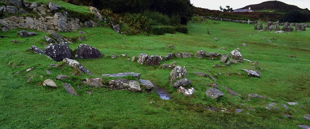 The joined stone huts at Drombeg Stone Circle - The Irish Place