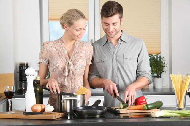 Couple cooking together on National Cooking Day 2019