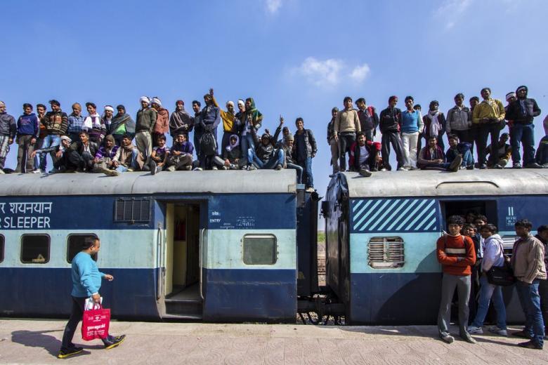 Мигранты-безбилетники: верхом на поезде! фото 1