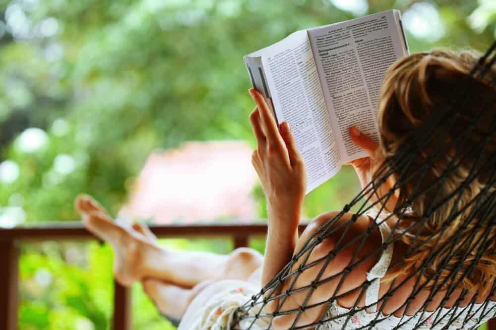 relaxing garden - reading in a hammock