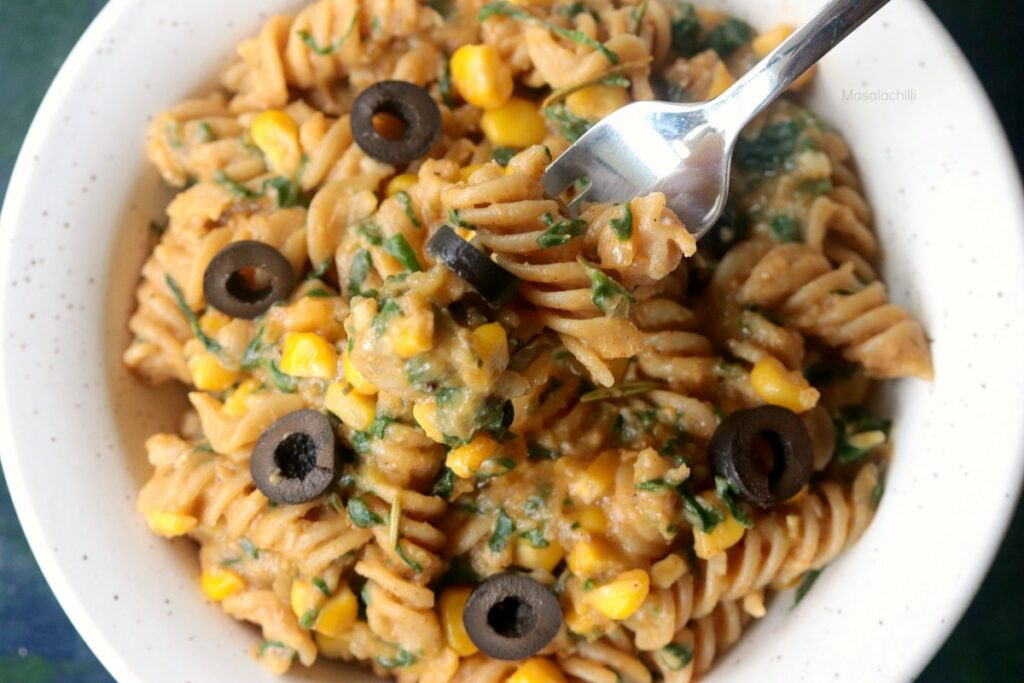 Creamy Pumpkin Sauce Pasta with black olives, spinach and corn