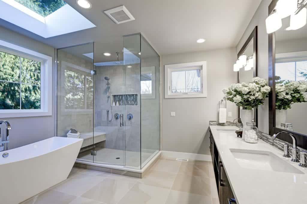 Modern gray bathroom with skylight over tuv