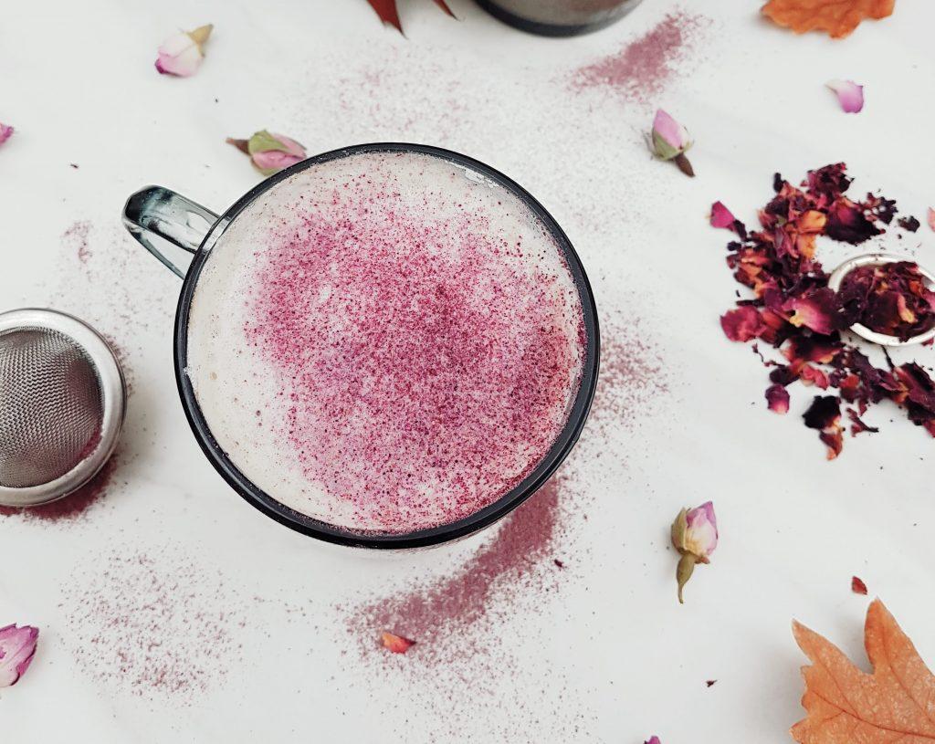 Rose milk tea with pink dust as garnish.