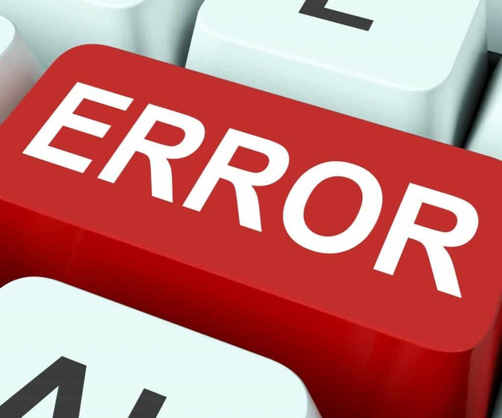 Red Error button on white keyboard.
