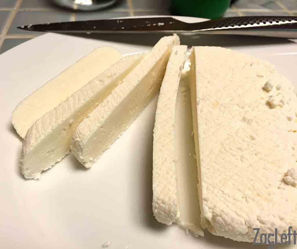 Fresh sliced paneer on a cutting board
