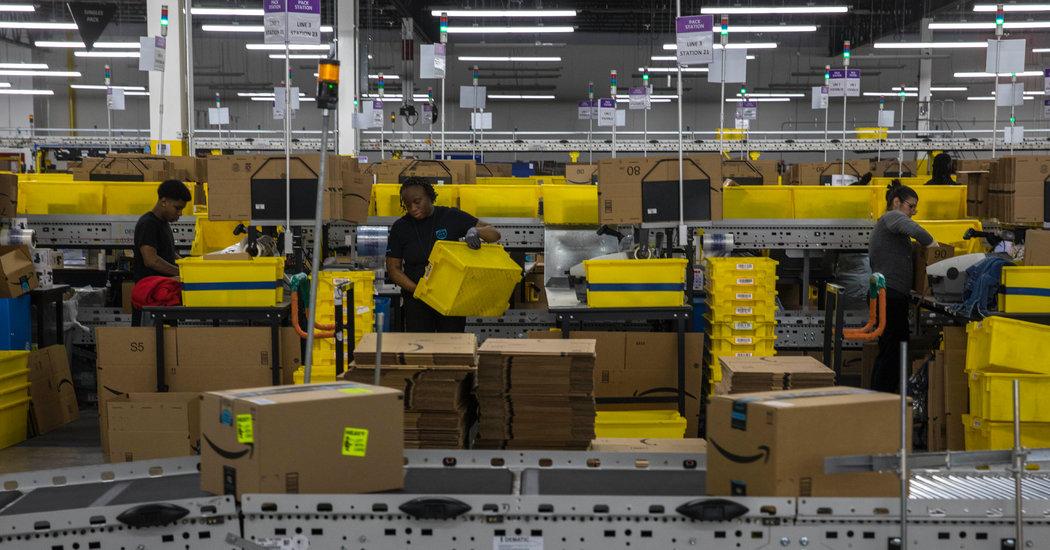 Inside an Amazon Warehouse, Robots' Ways Rub Off on Humans