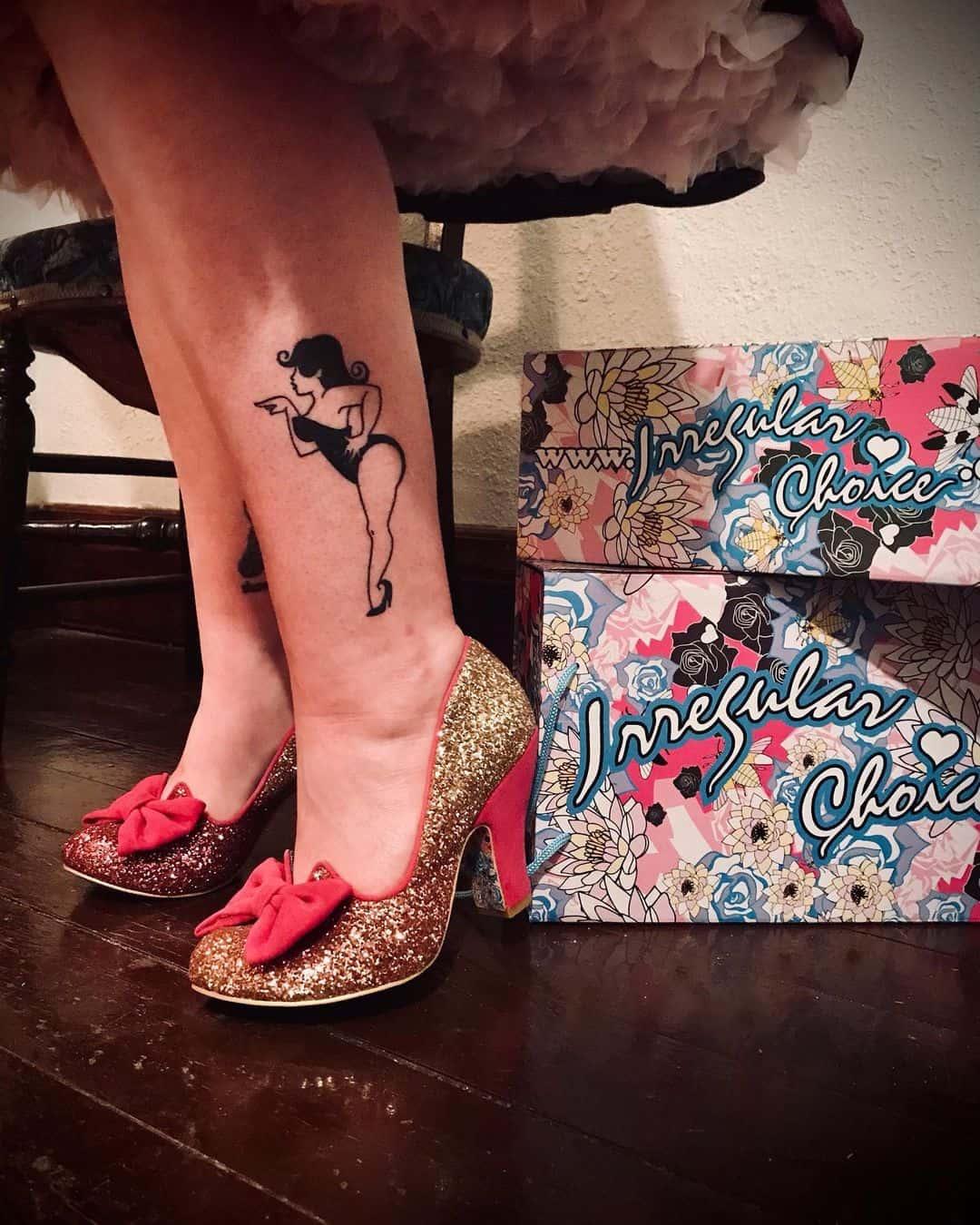 Pin-up girl tattoo 1