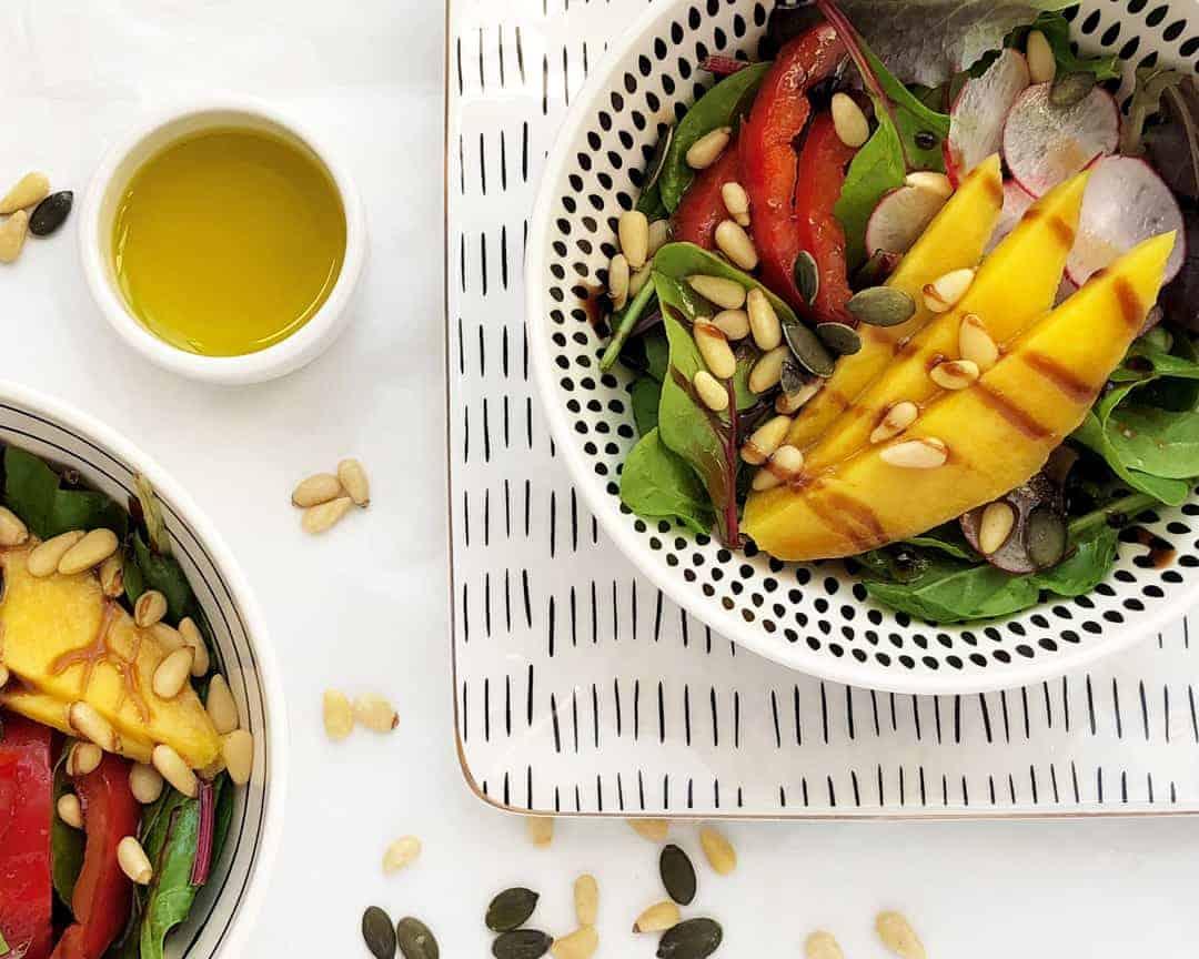 Green mango, pine nuts and homemade dressing salad