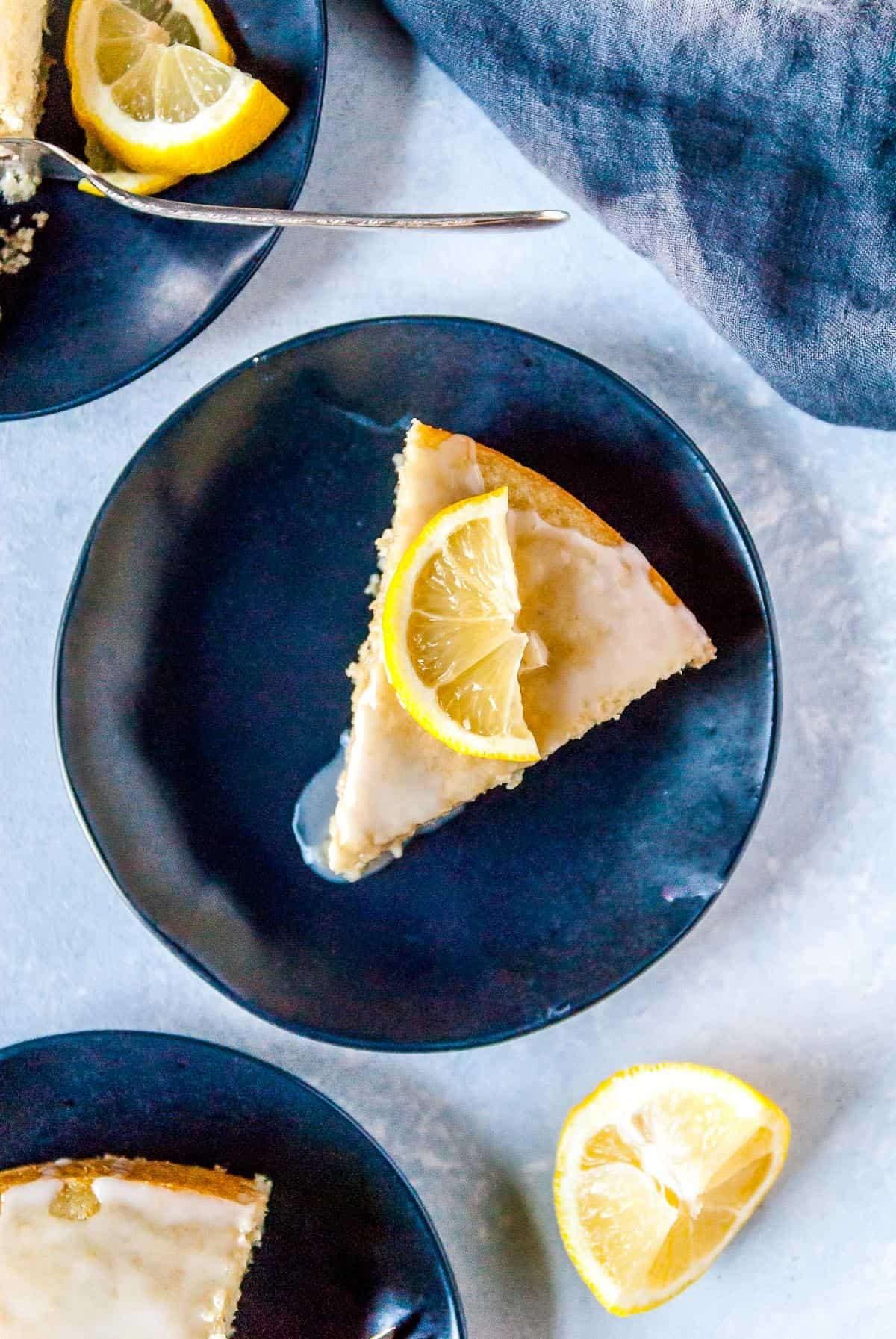 slice of vegan lemon cake on a plate