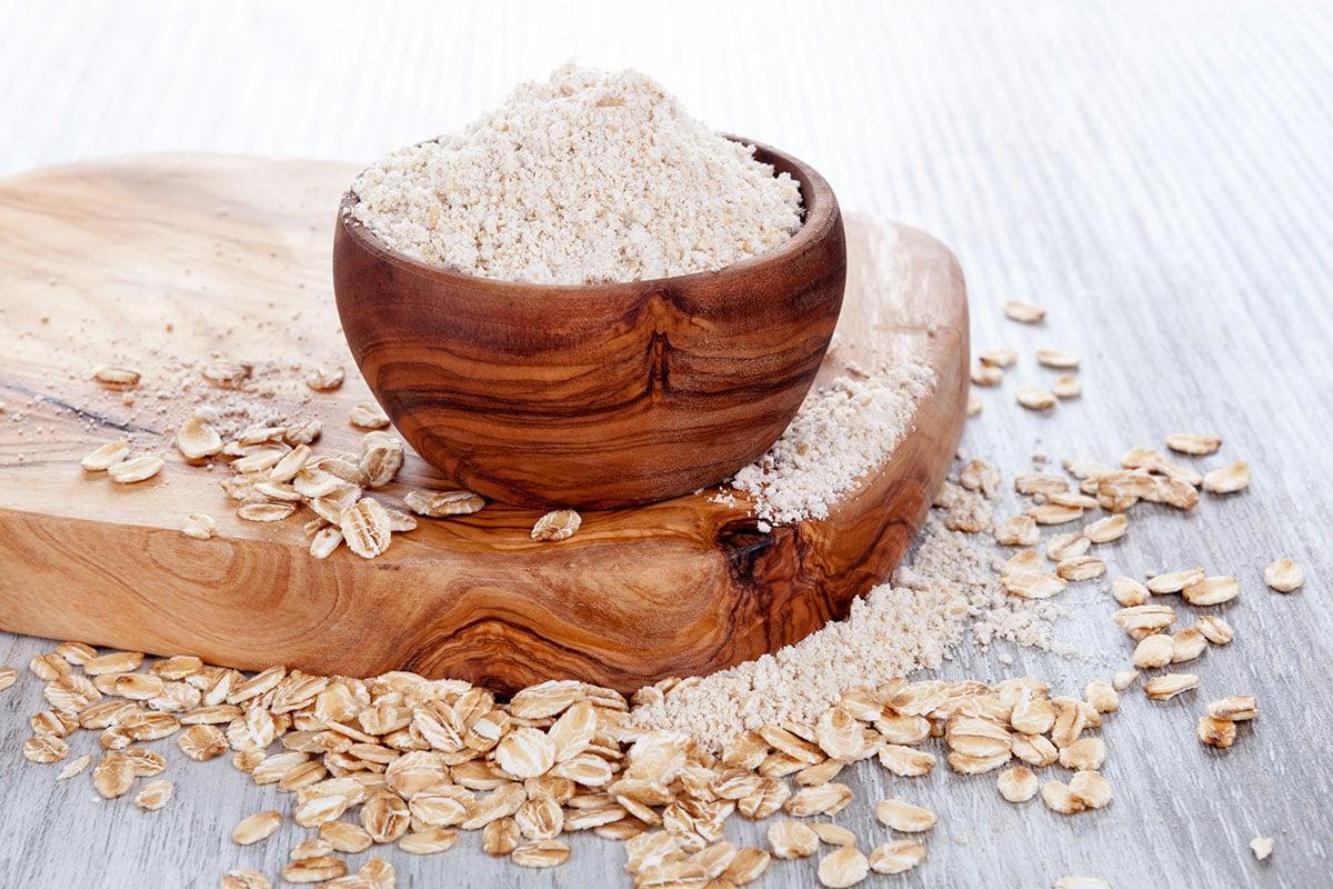 oat flour on wooden cutting board