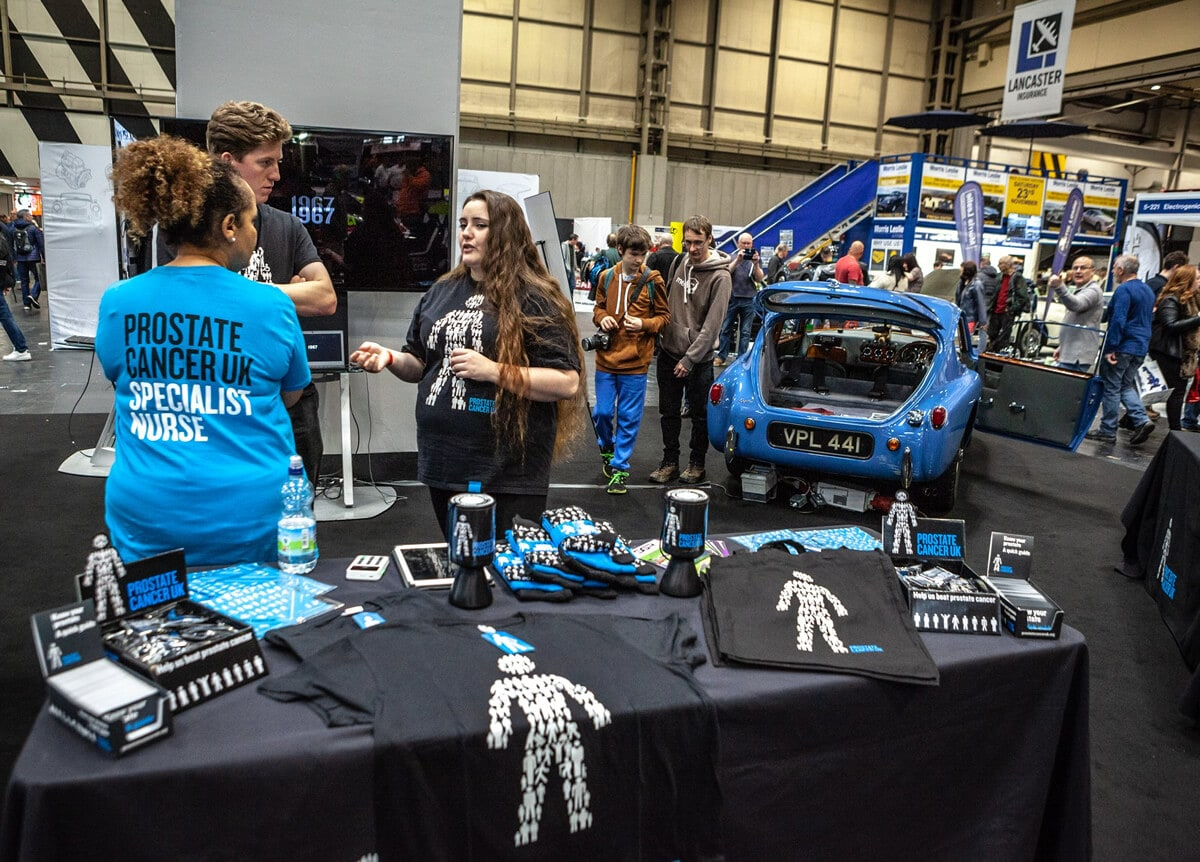 Prostate Cancer UK team in the Classic Car Show NEC 2019 with AC Bluebird