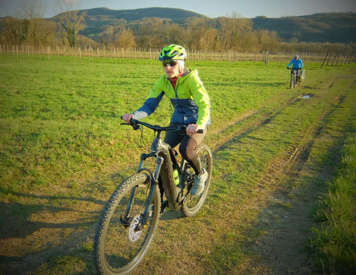Lady riding rental ebike in the Vipava valley. Photo by RockVelo