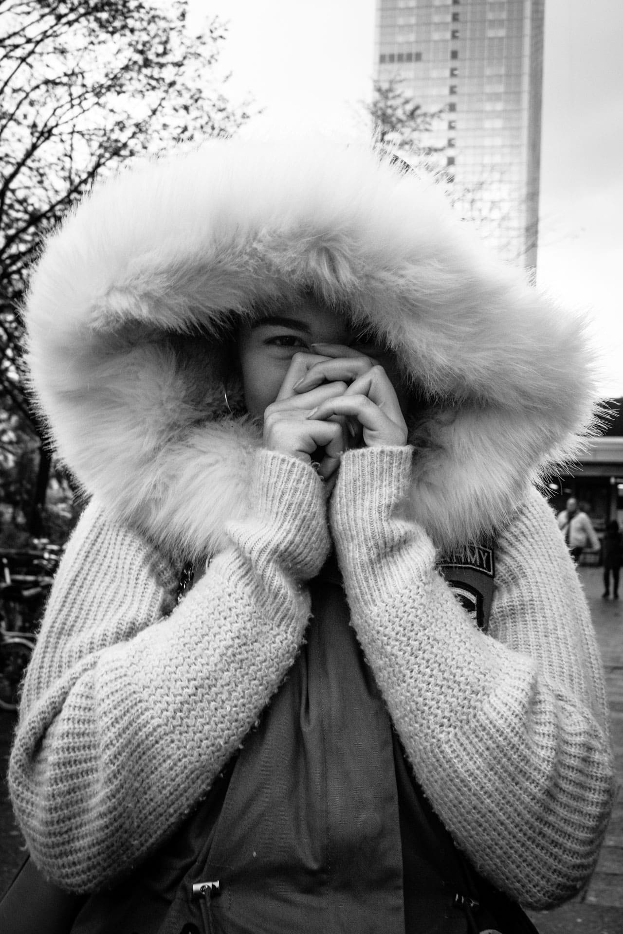 Shy girl with fur hat.