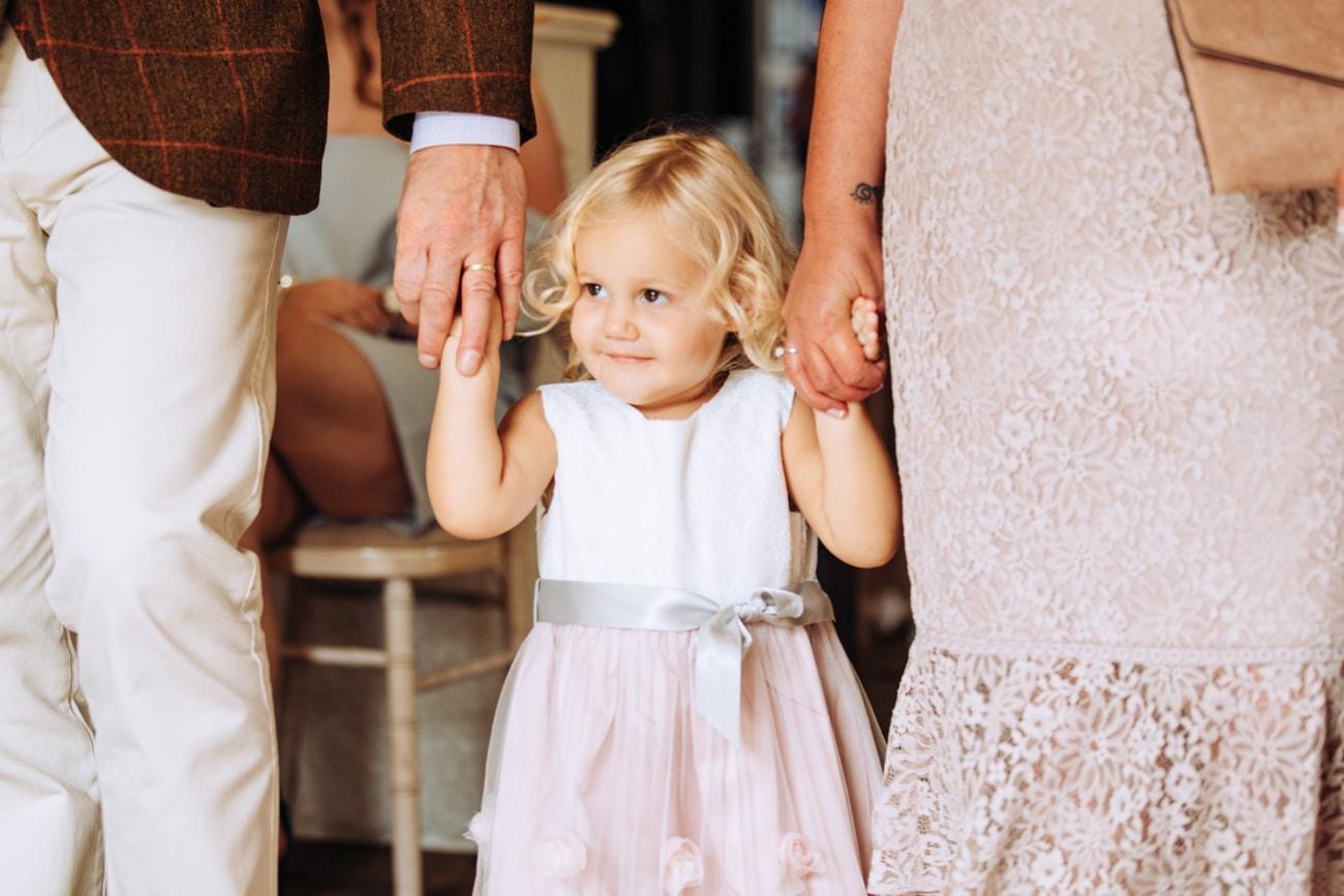 brides daughter walking down asile