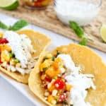 fish tacos with peach corns alsa and basil crema
