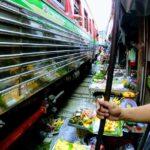 Maeklong Railway Market between trains