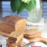 Molasses seed bread on wooden cutting board