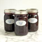 three jars of homemade Concord Grape Jam