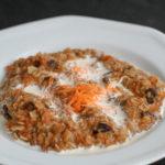 White bowl of carrot cake oatmeal.